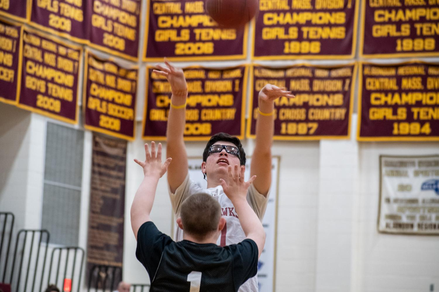 Junior Jack O'Connor shoots the ball over a Marlborough opponent on Oct. 22.  The unified basketball team won the game 60-30.