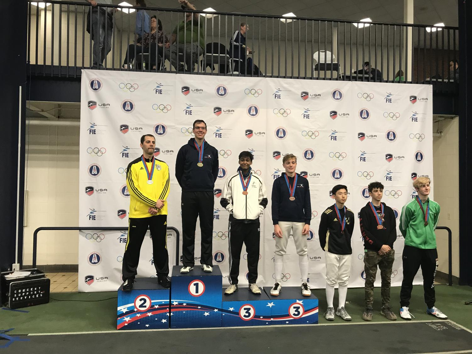 Senior Arthur Andreev [fourth from left] at the American Challenge in Madison, New Jersey on Oct. 6 2019.  Andreev tied for third in the Div 1-A Men's Épée event.