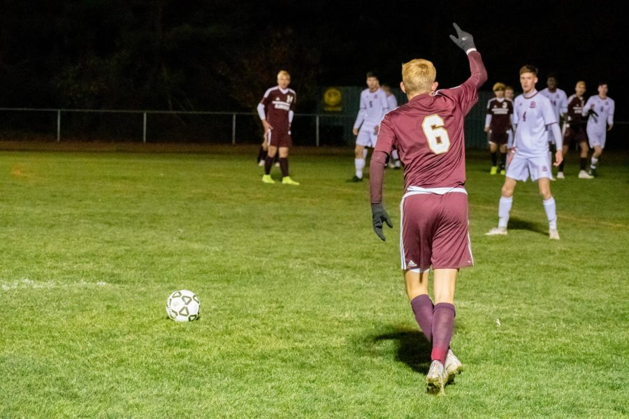 Junior Carsten Boloz kicks the ball into play against Westborough in the CMass Quater Finals. The team lost to Westborough 2-1 in double overtime.