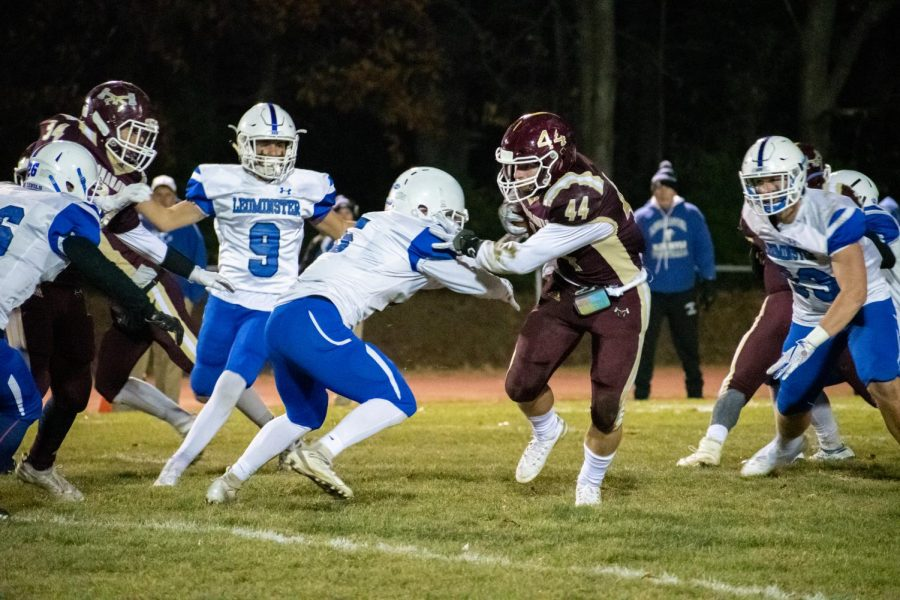 As he sheds a tackle from a Leominster opponent, junior Rio Ferguson moves towards the end zone. Ferguson finished the game with 129 yards and a touchdown.