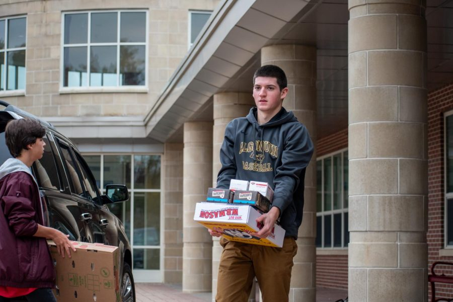 Senior Sam Slovin helps load food at the end of the October food drive. This year, student council led a fall food drive because there was no food at the Northborough Food Pantry.
