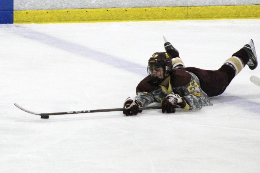 Alumnus Curtis Pietropaolo dives for the ball in the 2019 winter season.