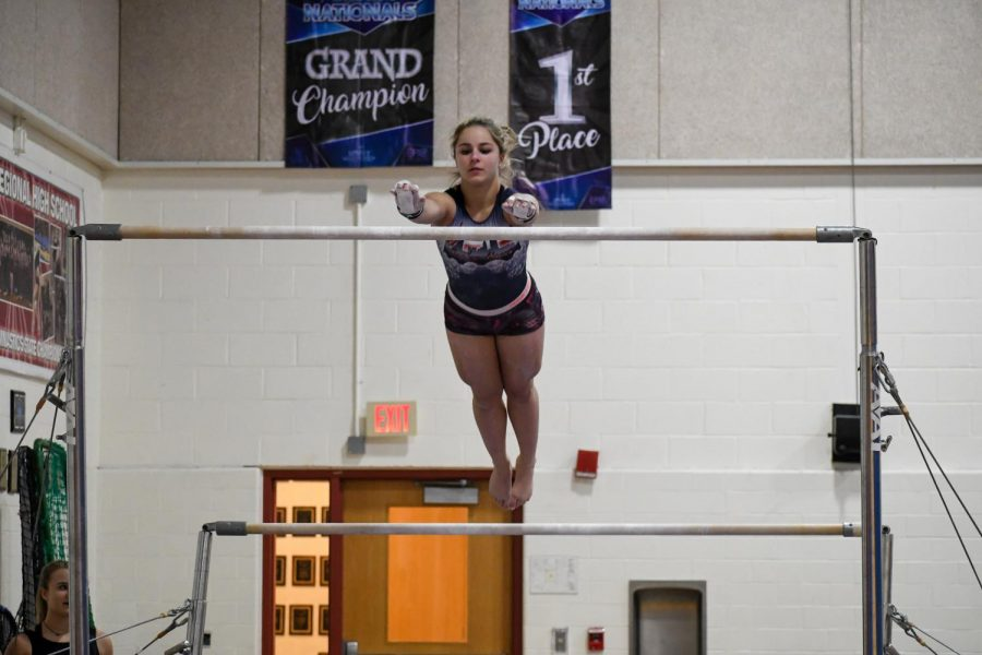 Sophomore+Lizzy+Debroczy+practices+on+the+bars+on+Dec.+5.+Debroczy+won+the+individual+all-around+title+last+season.