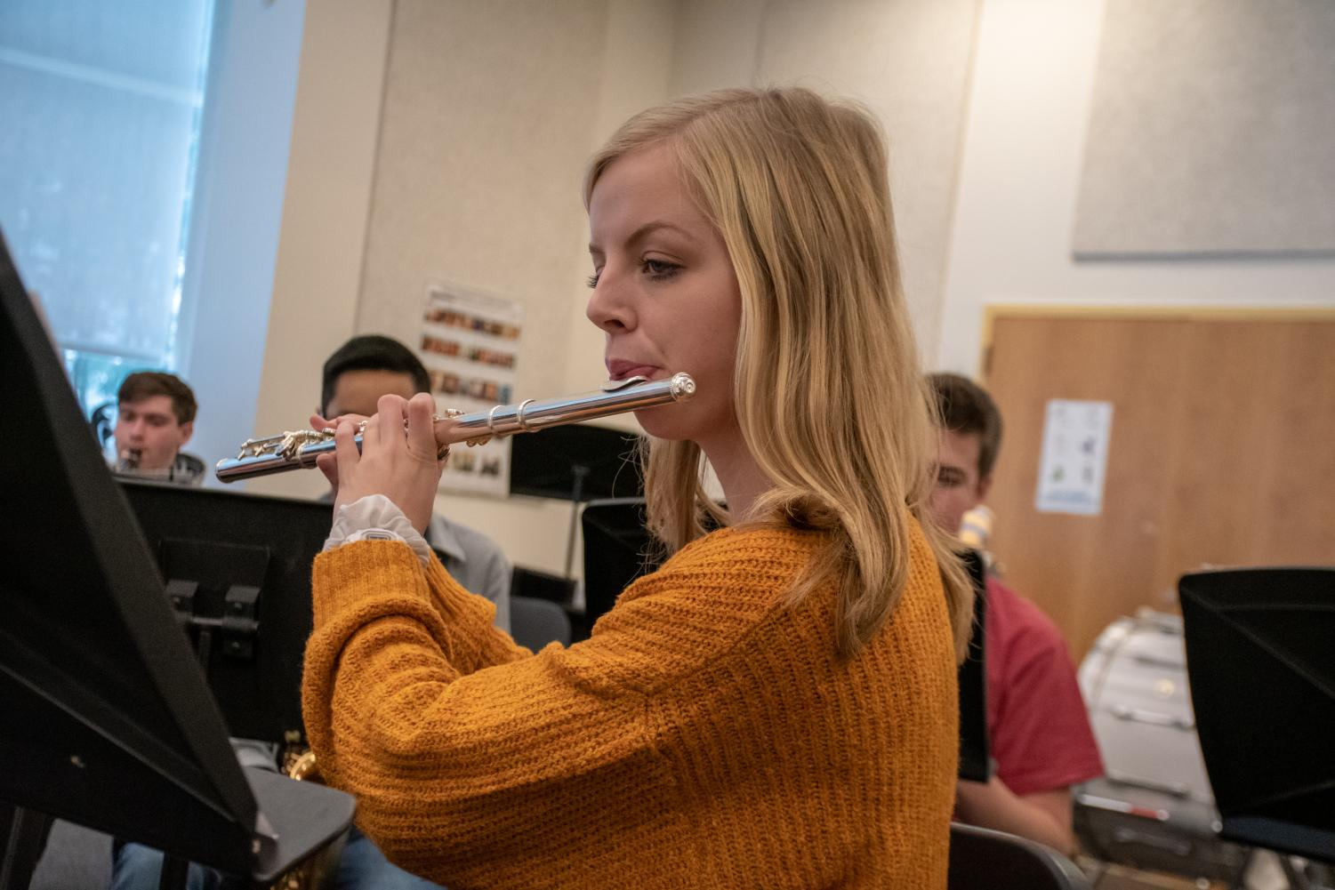 Senior Abby McCue plays her flute as a part of the wind ensemble. For the fall concert, McCue composed an original piece for the ensemble to play.