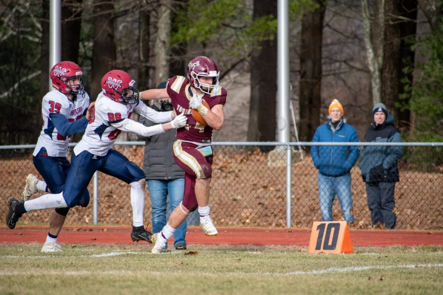 Determined to get down the field, junior captain Rio Ferguson breaks apart from the Westborough defenders and charges towards the end zone. Ferguson ran for 260 with one touchdown as Algonquin won the game 24-7.