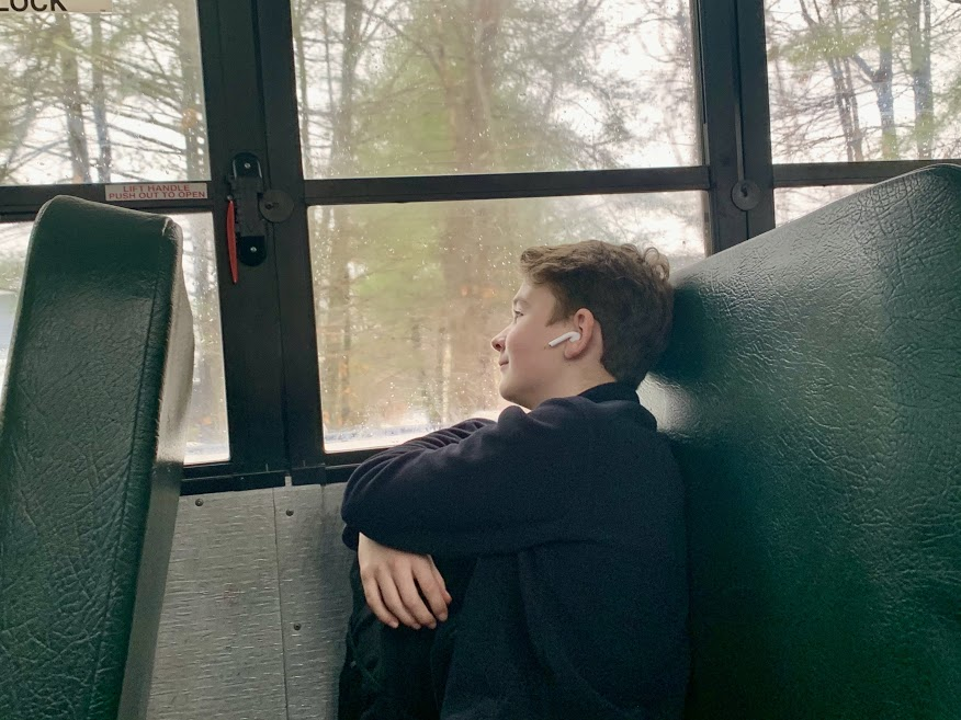 Freshman Patrick Hanlon listens to music, taking a minute to breathe on the bus ride home after a long day of school.