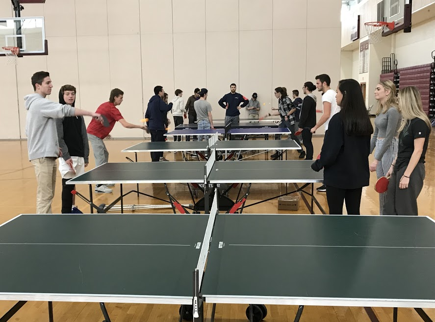 A group of seniors have an intense ping pong battle during their gym class.