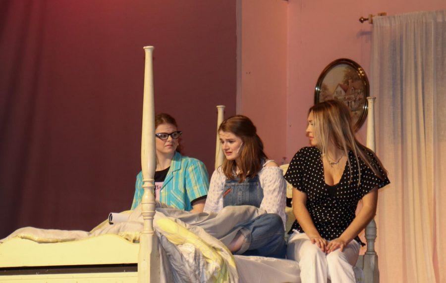 Rosie (senior Kaitlyn Wilber on left) and Tanya (senior Samantha Hostage on right) comfort Donna (junior Miranda Slingluff in middle).