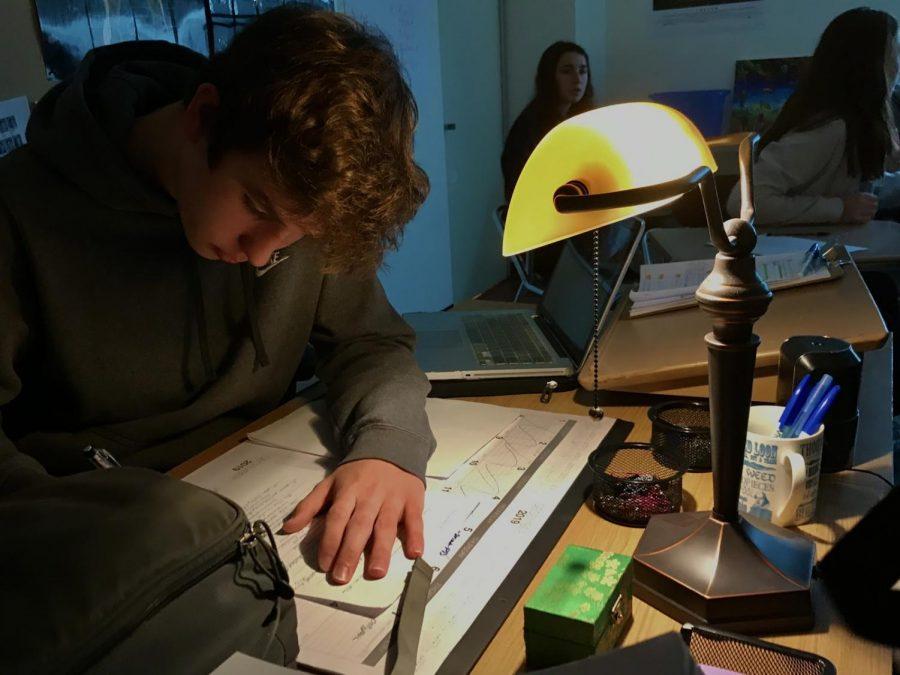 While sitting at the teacher's desk, freshman Matt Pianka studies the complicated love story of Romeo and Juliet.