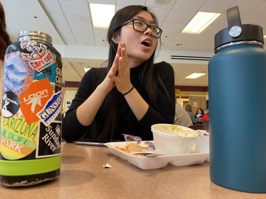 After devouring her soup and sandwich, senior Apple Lin has an intense talk with her friends.