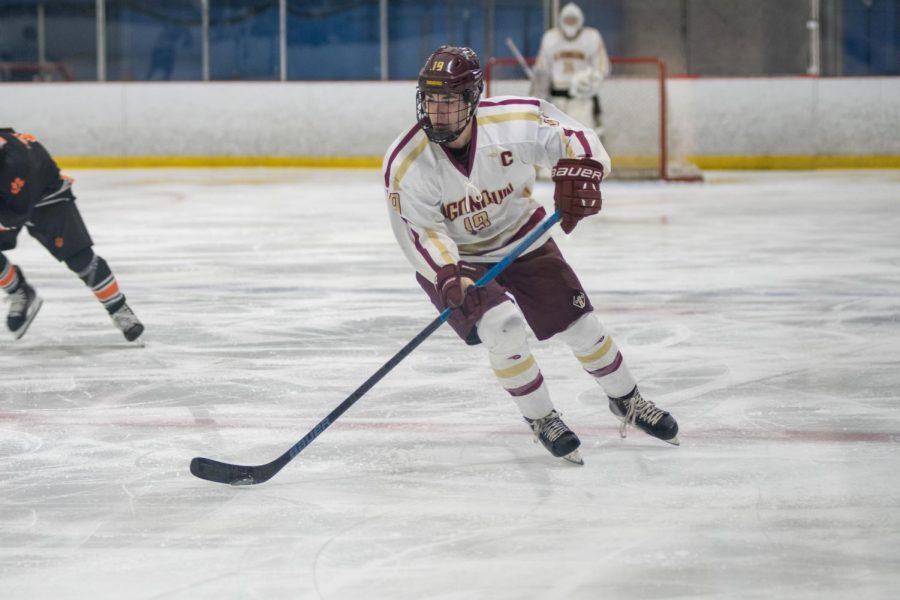 As he gains control of the puck, senior Ben Macaulay is focused as he moves towards the goal. Algonquin was defeated by Marlboro 4-1.