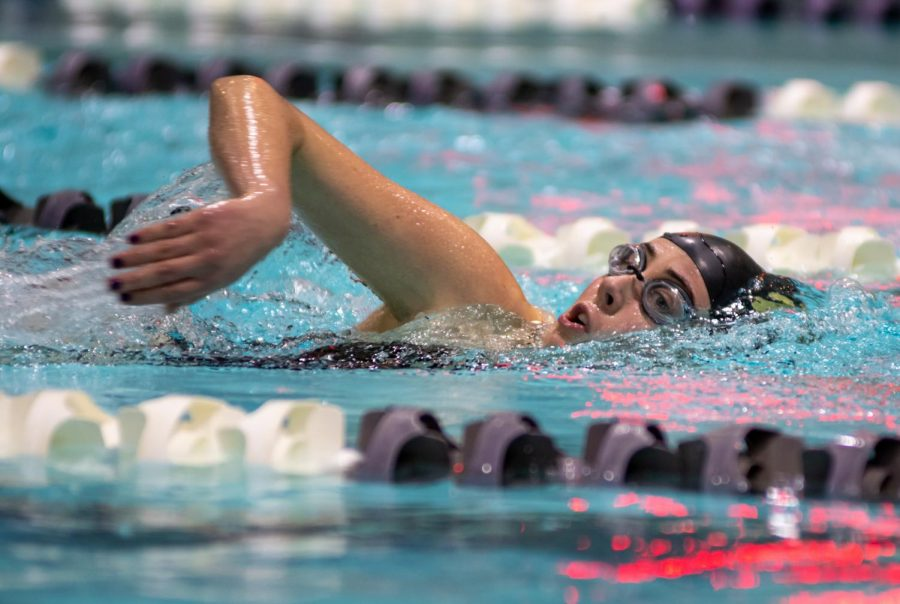 In a meet against AMSA on Jan. 16, senior Sara Prendergast takes a breath in the 500 freestyle event. Algonquin took the victory.