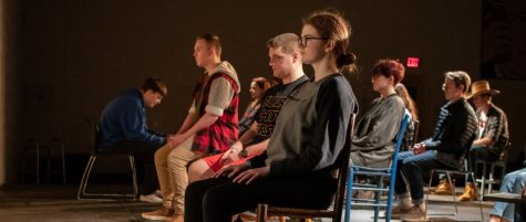 """Junior Miranda Slingluff sits on stage during rehearsal of """"The Laramie Project,"""" this year"""
