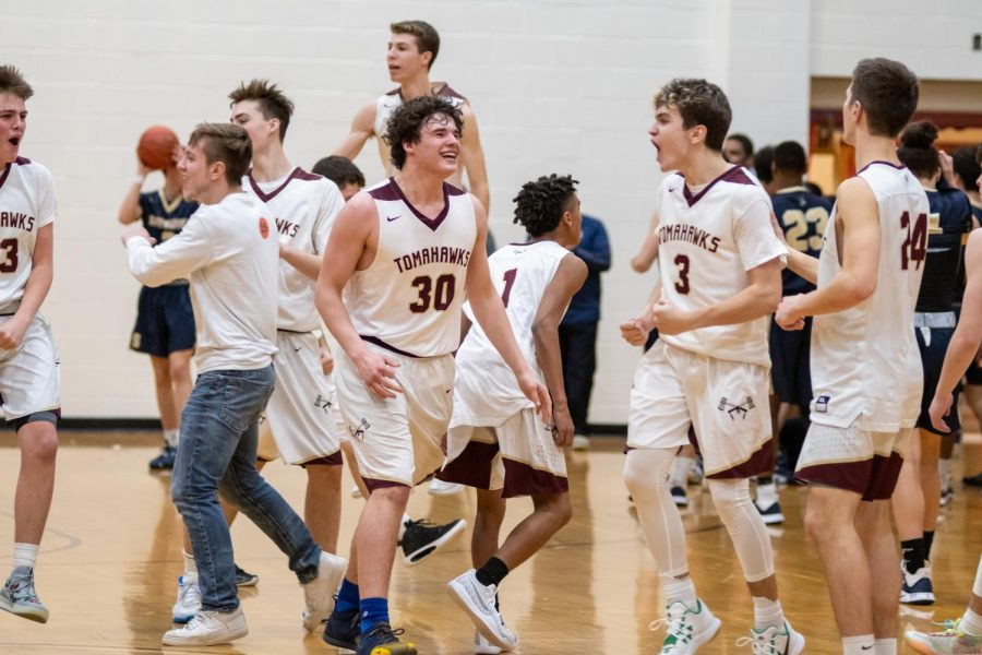 When the buzzer sounds at the end of the game, the team celebrates. Following this big victory, their record moves to 10-7 on the season.
