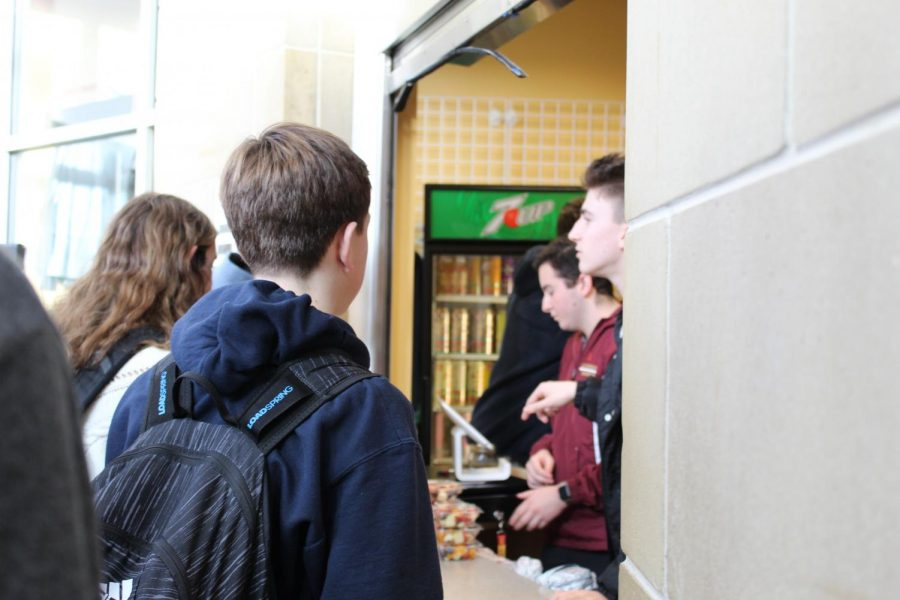 During the 10-minute mindful moment in between periods 2 and 3, students line up to purchase Chick-fil-A and other snacks at the school store.