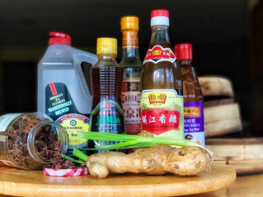(From left to right) star anise, soy sauce, sesame oil, Beijing rice vinegar, Zhenjiang vinegar, hoisin sauce, ginger and scallion.