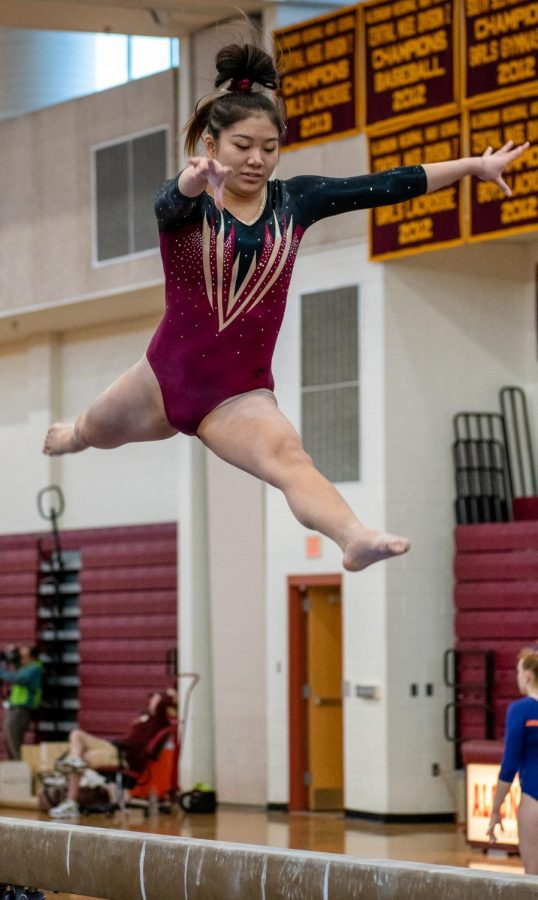 Soaring+in+the+air%2C+junior+Acacia+Truong+performs+her+beam+routine.+Truong+scored+a+9.45+on+beam.+