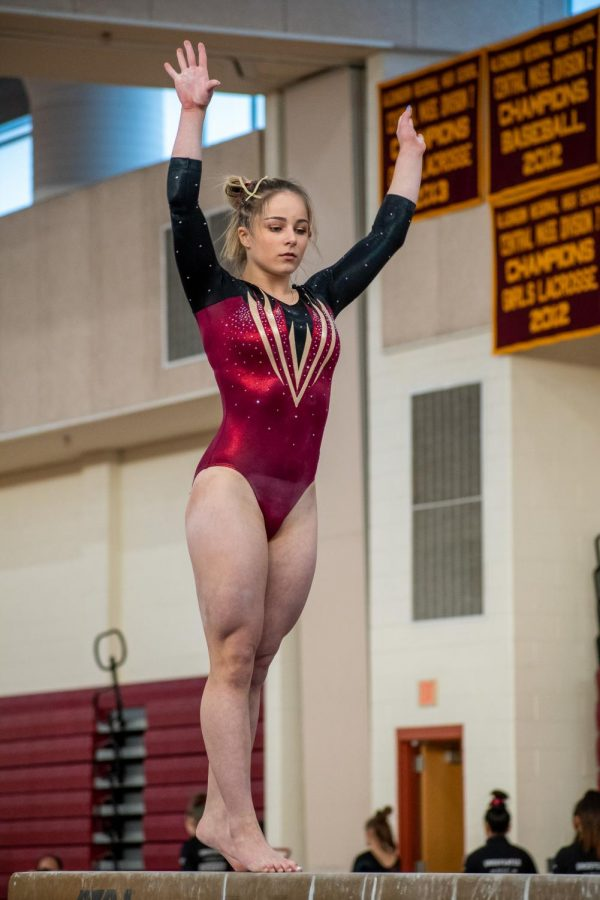 As she concentrates, sophomore Lizzy Debroczy continues her beam routine. Debroczy scored a 9.775 on the beam which was the highest for the team.