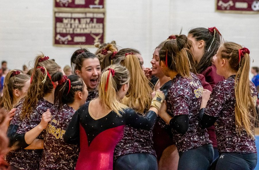 After her strong bar routine, sophomore Anna Haven is surrounded by her teammates as they celebrate. The team went on to finish second place at the State Finals and move on to the Varsity New England Championship, which will take place Saturday, March 14 in Fairfield, Conn.