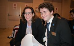 Senior Paul Probst poses with DECA adviser Patricia Riley during the 2020 DECA State Career Development Conference in Boston. As president of the club, Probst is responsible for the chapter's logistics for this conference.