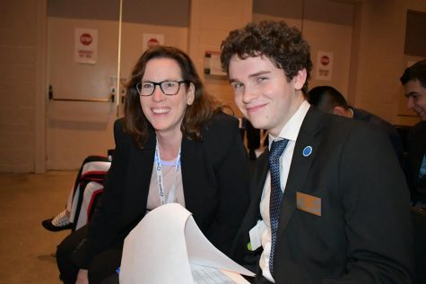 Senior Paul Probst poses with DECA adviser Patricia Riley during the 2020 DECA State Career Development Conference in Boston. As president of the club, Probst is responsible for the chapter