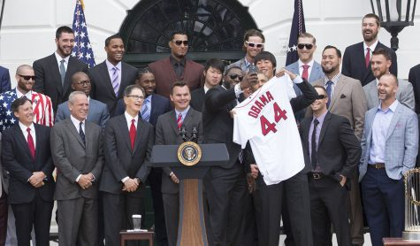 David Ortiz takes a selfie with President Barack Obama as the President is presented with a team jersey during an event to welcome the Boston Red Sox to the White House to honor the team and their 2013 World Series Championship, on the South Lawn of the White House, April 1, 2014. This event also including a speech from Ortiz about the Boston Marathon Bombing. Photo Editor Jonny Ratner writes that sports (or the lack of sports) can bring people together in a unique way.