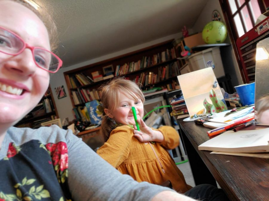 Art+teacher+Rebecca+Duffy+and+her+child+while+remote+learning+from+home.