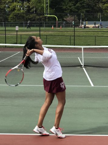 As she begins to swing overhead, senior Ruchitha Rajaghatta keeps her eye on the ball.
