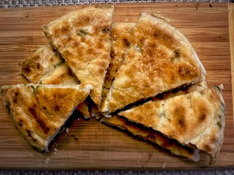 The best way to eat scallion pancakes is to serve it sliced into triangles like a pizza with a delicious dipping sauce.