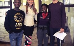 Sophomore Kiley Martin and Junior Philip Eppen with their Kenyan friends during a group activity.