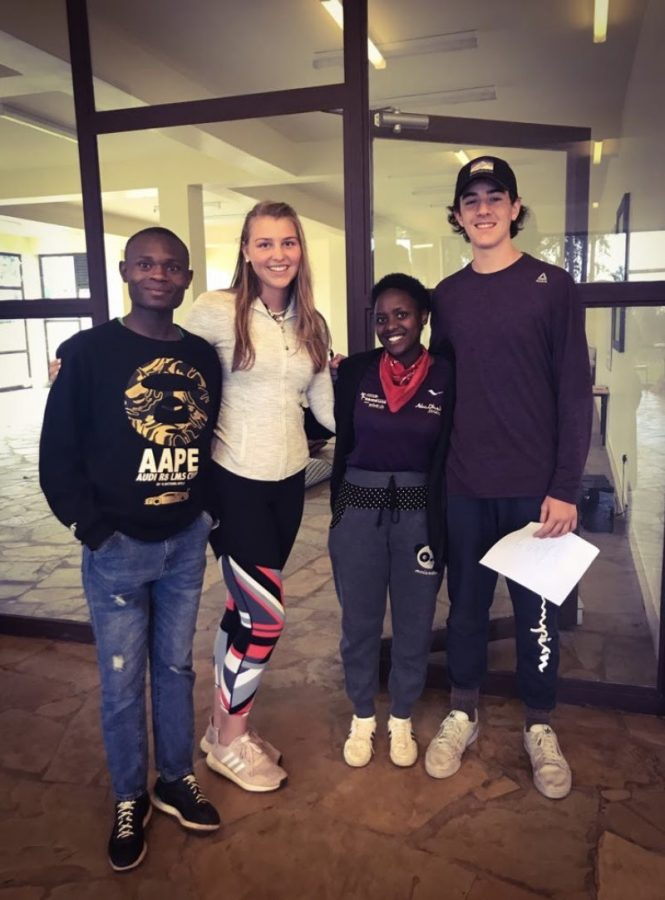 Sophomore+Kiley+Martin+and+Junior+Philip+Eppen+with+their+Kenyan+friends+during+a+group+activity.+
