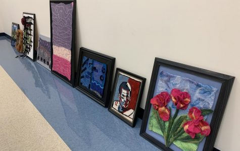 Cindy Kennelly dropped off a lot of her artwork to be shared at the show. Some were framed landscapes and portraits (featured) and others were felted objects (not pictured. We laid the works on the floor, as we waited for artists to come pick up their art from the previous gallery.