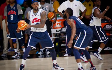 During a team USA scrimmage, Rockets guard James Harden defends Lakers forward LeBron James.