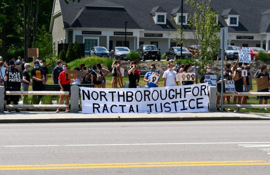 A large sign hanging from the edge of the common prompted many cars to honk in support as they passed.