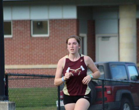As she looks at the runners ahead of her, senior Allison Subat finds a comfortable pace at a cross country meet last season.
