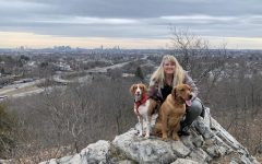 Science teacher Susan Vaughan poses with her dogs, Maggie, a red and white Brittany, and Rudy, a red lab, at Middlesex Fells Reservation in Medford.