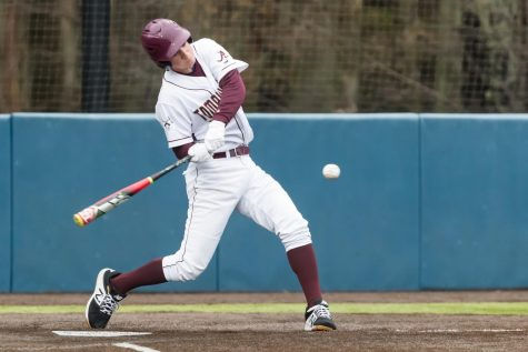 Senior Sam Slovin swings in hopes of a home run in one of his final baseball games last season.