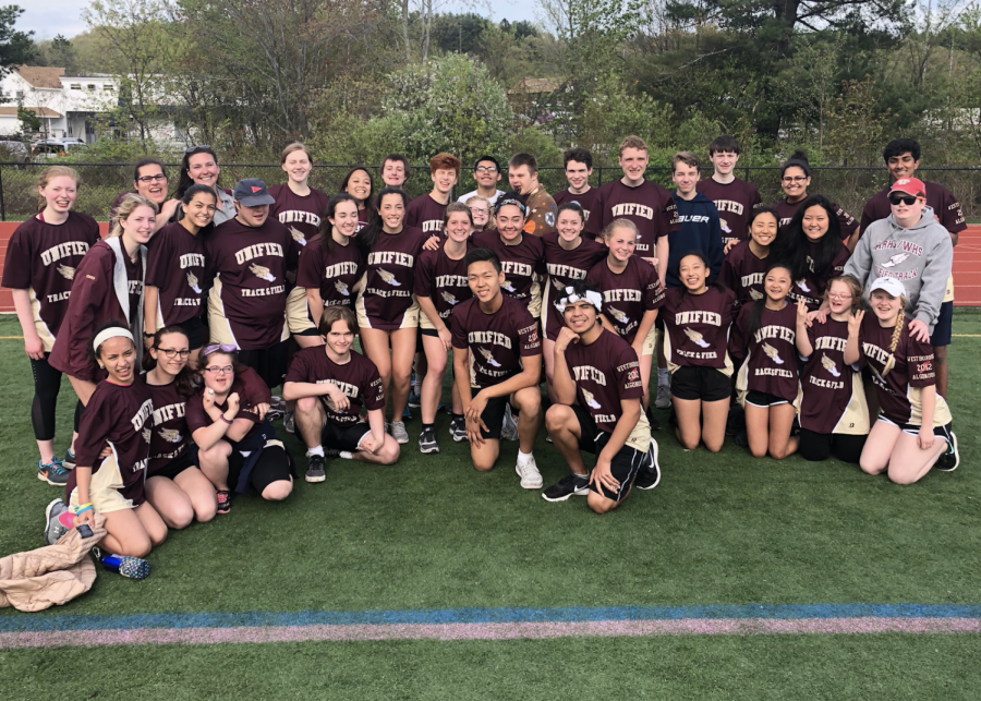 The 2019 season unified track team poses for a photo during a meet.