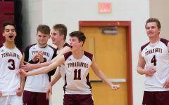Senior Will Hurley (number 11) cheers with his teammates after a great play.