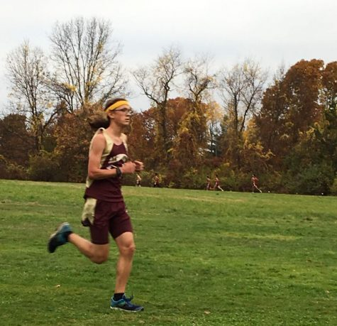 After settling into his race, senior Zane Walter looks to pass a pack ahead of him in a cross country meet.