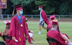 Navigation to Story: Class of 2020 graduates with close to normal, long awaited outdoor ceremony