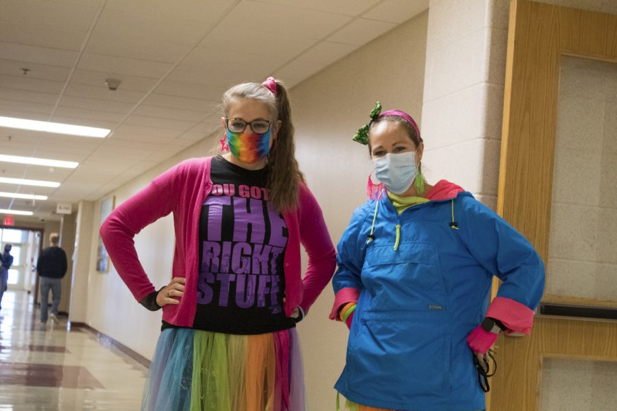 Along with the rest of the social studies department, social studies teachers Kristen Turner and Renee Moulton dress in head to toe neon for their 80's theme Halloween costume.