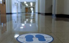 Markers placed on the floor in the hallway remind students and staff to stay socially distant, an implementation of one of the mitigation strategies put in place by the Medical Advisory Team.
