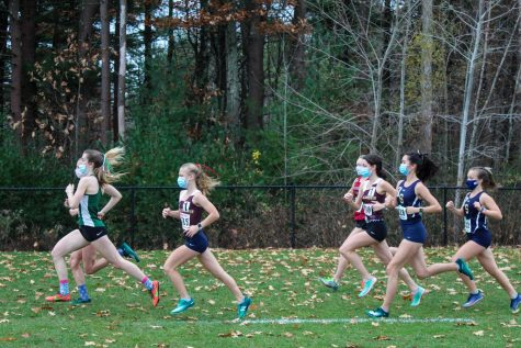 Sophomore Ada Gebauer and senior Anna Long run in the first and fastest wave of the pod 8 meet on November 11.