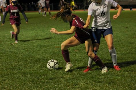 Junior Serena Mihalek pushes her way towards the ball despite the uncalled shirt tug penalty by her Westborough opponent. Westborough put up a good fight against Algonquin however, it was not good enough as Algonquin took the title of Pod 8 champions on November 12.