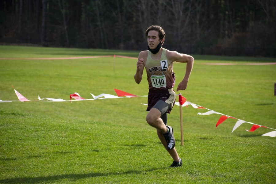 Junior Jackson Reusser heads for the finish line at the November 11 boys cross country pod 8 meet.