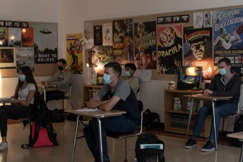 In English teacher Alex Silva's class, senior Hayden Rosenberg sits six feet apart from his classmates to follow proper safety guidelines during class.