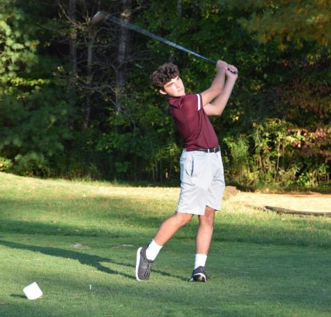 Freshman Luke Palma follows through on his shot off the tee. After a hard fought game, Algonquin lost against Wachusett 168-160.