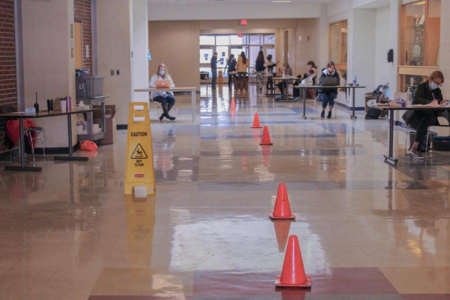 Due to the upcoming winter break, COVID-19 testing was offered to high school students on Monday and Tuesday. Orange cones line the auditorium hallway to help keep students socially distanced while waiting to check in for their free test.