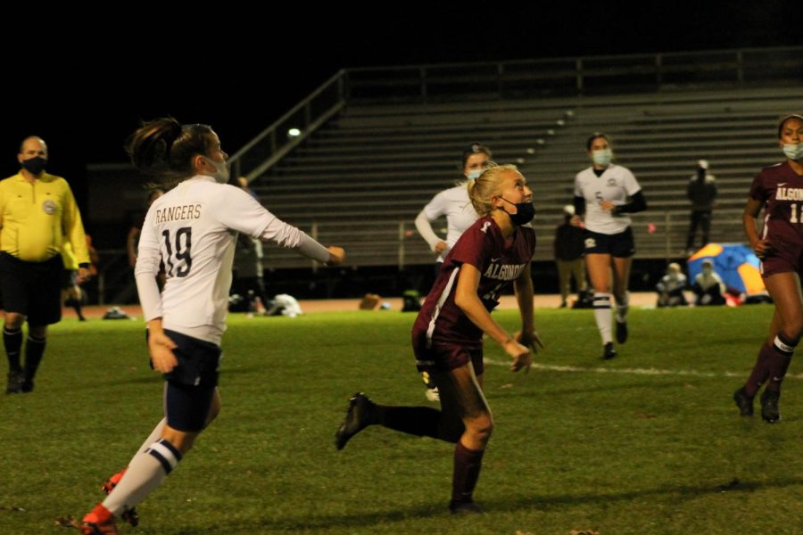 Senior Lola Mahoney eyes the ball, preparing to get it as soon it lands. The girls became Pod 8 champions, defeating Westborough with a score of 1-0.